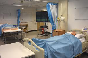 inside a mock ward with a synthetic patient lying on a bed