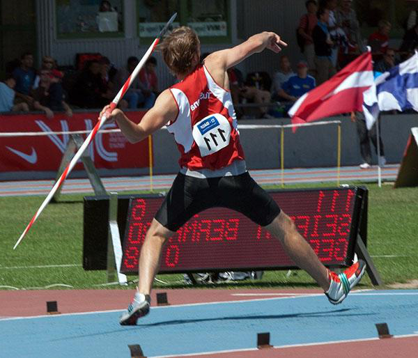 A man is throwing a javelin