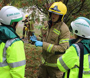 Discussion between three emergency service personnel