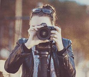 A girl is taking a photograph
