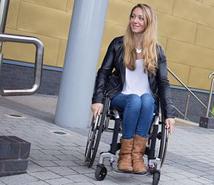 young woman with long blonde hair in a wheelchair