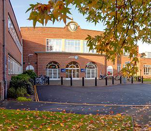 entrance to the university of worcester with autumn colours